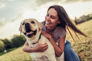 Walking a dog for exercise outdoors